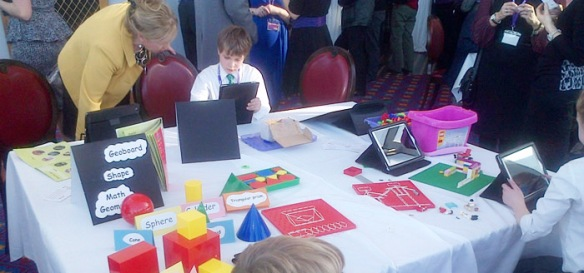 Schoolchildren immersed in the accompanying exhibition